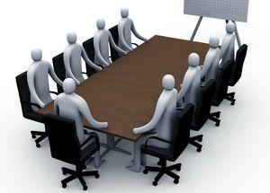 работники за столом