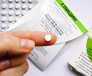 таблетка на пальце
